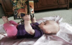 Little Cute Baby Reading a Book